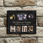 Engraved family picture frame on brick wall