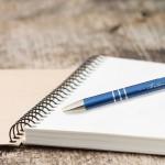 Engraved metal pen on notebook