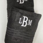 Black towels with monogrammed initials